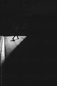 Man walking in the street by Wave   Stocksy United