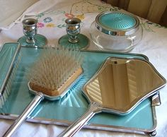 Vintage vanity set done in silver and gilt with turquiose guilloche enamel ont the top of the mirror, brush, jar for hair, 2 candle holders with it on the bottom and the whole tray.