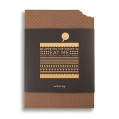 A book about designs related to food - shaped like a wafer that has had a bite taken out of it.