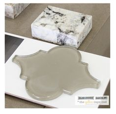 I love this morrocan gray glass tile   The Yellow Cape Cod
