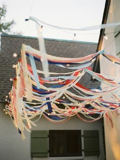 Streamers & Party Lights   an easy way to do the ceiling decorations.    you can also do it with the fringe things