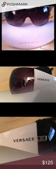 Versace White Wraparound Sunglasses. Versace White Wraparound Sunglasses. Authentic Versace sunglasses. Very good condition, no scratches. Comes with authentic Versace White case. Versace Accessories Sunglasses