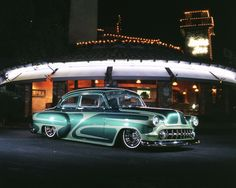 Aaron Lobato of Rio Rancho, New Mexico, built his '53 Chevy much like it would have been done in the late-'50s: subtle bodywork and wild paint. He sprayed the basecoat and Watson-style scallops in pearl metallics with a hint of 'Flake thrown in. We'd like to think this photo shoot in front of the Paso Robles Inn paid homage to the Jim Potter sessions of yesteryear.