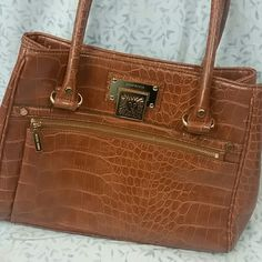 Anne Klein Purse Large purse. Zips in the front. Button pocket in the back. Buttoning opening on the inside with several pockets and zip pockets. The front handle does show some wear as seen in picture 3 Anne Klein Bags Shoulder Bags