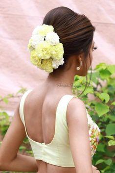 Pastel Yellow Lehenga styled with pastel white & Yellow carnations, how pretty it can be.    #Indianweddings #shaadisaga #indianbridalhairstyles #hairstyleswithflowers #intimatewedding #realflowers #uniquecolourlehenga #babybreaths #lowbun  #exoticflowerhairstyle #carnations Simple Bridal Hairstyle, Bridal Hair Buns, Bridal Braids, Indian Bridal Hairstyles, Loose Hairstyles, Bride Hairstyles, Bridal Hairdo, Hairstyle Ideas, Sonam Kapoor Hairstyles
