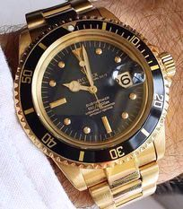 Rolex Oyster Perpetual Submariner Date 200m. Gold with Black bezel and Dial.