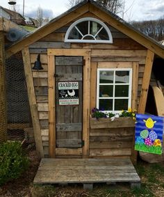 A chicken coop made out of pallets.