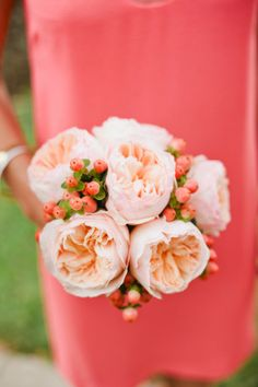 peach garden roses with coralish orange coffee bean berries