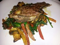 Lamb with sauteed spinach, peppers and mushroom.
