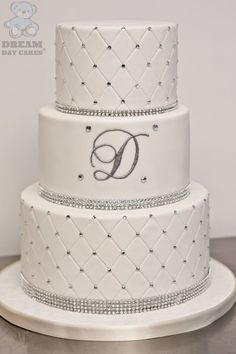 With white or ivory fondant & pearls, no bling!