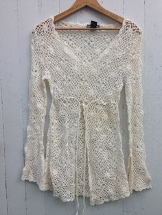 A personal favorite from my Etsy shop https://www.etsy.com/listing/479749543/vintage-90s-crochet-ivory-bell-sleeve