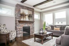 This LDK custom living room features an incredible stone fire place, large windows, and exposed ceiling beams! Stunning! If you are looking to customize your very own home, we would be happy to help! Check out our website for more details about LDK Homes and our custom work!