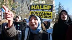 "Protesters in Turkey hold a placard reading ""Aleppo is the world's shame"" (15 Dec)"