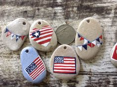 USA STONES...2 hand painted pendants jewelry making by madeforfun... This would be a fun project with family and friends for the 4th of July! All red,white and blue rocks!