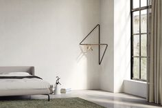 Ugao: a clothes rack that saves space in the corner of a room - designed by Simon Morasi Piperčić for Ligne Roset