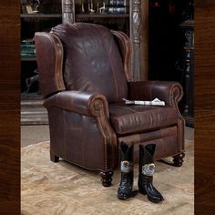 """A great recliner with comfort and class galore!! Measures 33"""" D, 38"""" W, 43"""" H Please call the store for additional information and pricing. 817-244-9377"""