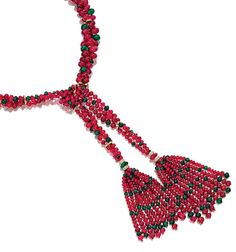 RUBY, EMERALD AND DIAMOND NECKLACE, VAN CLEEF  ARPELS, 1972 Designed as a stylised scarf, set with three graduated rows of ruby and emerald beads joined by single-cut diamond set rondelles, embellished at each extremity with a similarly set tassel, mounted in yellow gold,