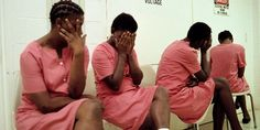 I am designing a dress or jumpsuit for woman in prison, this picture is showing woman ashamed of to be pictured in prison