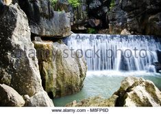 Aquatic waterfall in stone cliffs - Stock Photo