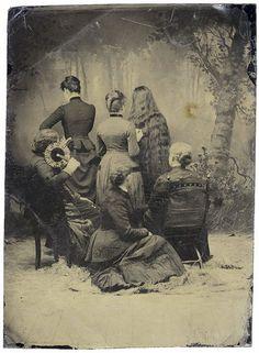 Group of Victorian women facing backward.