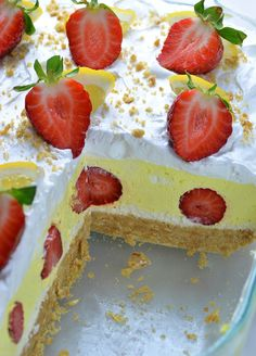 Strawberry Lemonade Lasagna in casserole. One piece is missing, you can see bottom Golden Oreo layer, yellow lemon layer with strawberries inside and whipped cream on top garnished with half cut strawberries.
