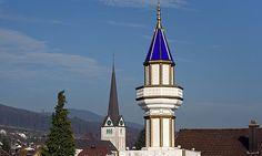 A minaret on the roof of a Turkish cultural centre in Wangen bei Olten, north-western Switzerland. Photograph: Fabrice Coffrini/AFP/Getty Im...