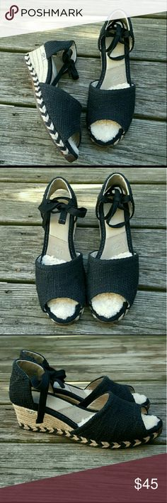 UGGS black and tan espadrilles Get ready for warmer weather!!!  Black and Tan woven ugg australia  espadrille sandals.  Tie ankle straps. Wool on at the ball of the foot. Arrow design around the base. Rubber sole.  2 inches heel  Excellent condition.  Size US 9 UGG Shoes Espadrilles