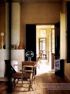 black shutters on tan walls and wood floors