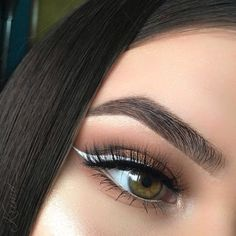 Perfect brows long lashes white winged liner
