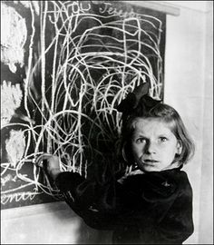 "this photo of a young girl. She had survived the Holocaust and after she was asked to draw what ""home"" looked like to her.  Not only is the drawing striking, but the look in her eyes unforgettable, eyes that can translate all that pain and suffering."
