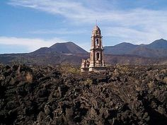 San Juan buried under lava flow with only church steeple top left exposed