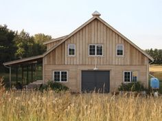 Grey breezeway doors and pale wood finish give this barn a weathered, but clean appearance. #BarnPros #kit #farm #gable