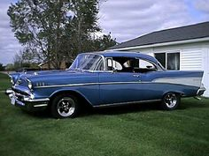 '57 Chevy My older brother had a '57 except his was Dk Blue with a light blue racing stripes down the center. LOVE this car!!