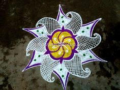 simple  white rangoli without dots,  I have added just two, three colours to finish this kolam
