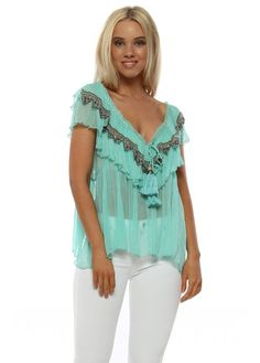 0a5540187b588 This Laurie and Joe top in exquisite aqua with beaded frills and tassel  ties, perfect beach cover up