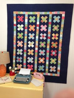 A Great Granny Squared quilt styled with the best #vintage props from Lori Holt's cottage!
