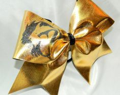 This bow measures 8 inches wide and 6.5 inches tall with a ribbon width of 3 inches. All ends have been heat sealed for fraying resistance. The bow is attached to a black pony tail holder.