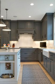 Cabinets are painted with Kendall Charcoal from Benjamin Moore. Alexander Design Group.