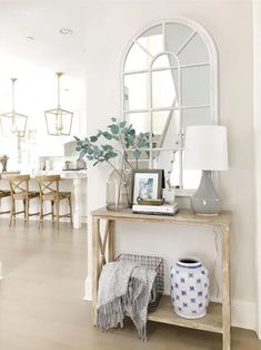 Entry way styling Benjamin Moore classic gray wood console table arched mirror neutral decor wood stools brass kitchen lanterns Interior Design Living Room, Living Room Decor, Flur Design, Home And Deco, Entryway Decor, Foyer Table Decor, Entry Table With Mirror, Front Entry Decor, Foyer Mirror