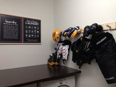 Peg Rack in the laundry room with my son's hockey equipment drying.