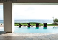 Main Floor - Beach Room that opens up to outdoor pool area.......BEAUTIFUL with the infinity pool.