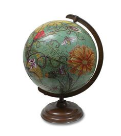 Old globe...beautiful with gorgeous flowers painted over the map.
