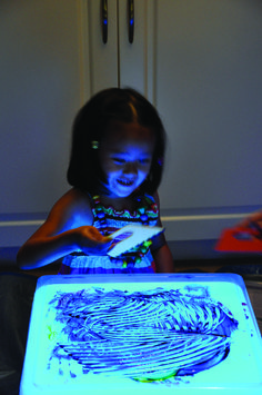 Painting on a light cube.