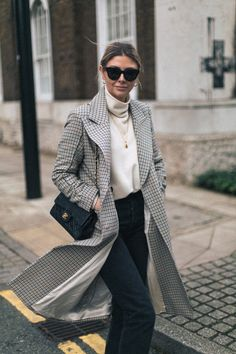 Emma Hill wears Celine Baby Audrey Sunglasses, check coat, off white sweater, black jeans, vintage Chanel bag, gold earrings, gold necklaces, chic winter outfit