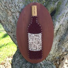 A personal favorite from my Etsy shop https://www.etsy.com/listing/452215148/made-to-order-wine-bottle-string-art