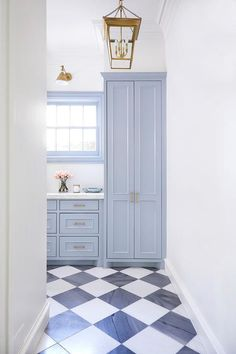 Katie Nixon Photography -Black and white harlequin floor tiles in a laundry mudr. Katie Nixon Photography -Black and white harlequin floor tiles in a laundry mudroom completed with Blue Laundry Rooms, Laundry Room Design, Küchen Design, House Design, Black And White Tiles, Black White, Blue Floor, Blue Cabinets, Blue Tiles