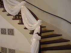 Indoor banister draped with tulle and lights