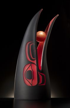 """Preston Singletary, """"Raven Steals the Sun,"""" blown, hot-sculpted and sandcarved glass, 2001. Collection of Michael and Cathy Casteel."""