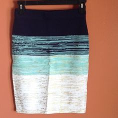 NWT XOXO Skirt NWT XOXO Skirt. Navy blue, mint green and gold (the gold is only in the front), tight fitting, comes a little above the knee, elastic waistband. 55% Rayon 4% Nylon. A little stitching came out of the band around the waist, only noticeable on the inside. XOXO Skirts