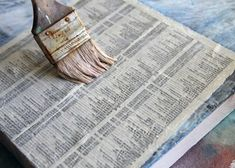 How to make a distressed vintage sign using canvas covered in newsprint.  DIY tutorial via lilblueboo.com